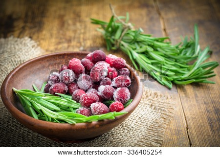Frozen cranberries and fresh rosemary. Ingredients for cooking - stock photo