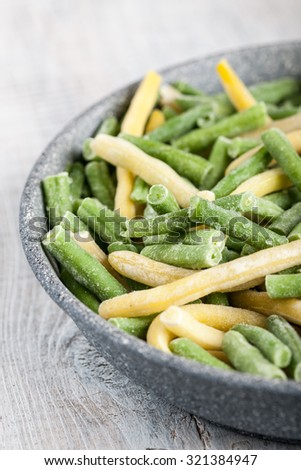 Frozen french beans in a pan