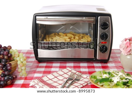 Frozen french fries bake in an oven