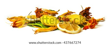 frozen fruit,  lemon juice frozen ice cubes isolated on white background. petunia, dry delicate flowers, leaves and petals of pressed, marigolds, Aquilegia Feminine, beauty and cosmetics concept - stock photo