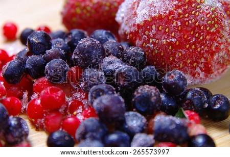 frozen fruit on a wooden surface