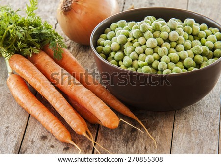 frozen green peas with carrots - stock photo
