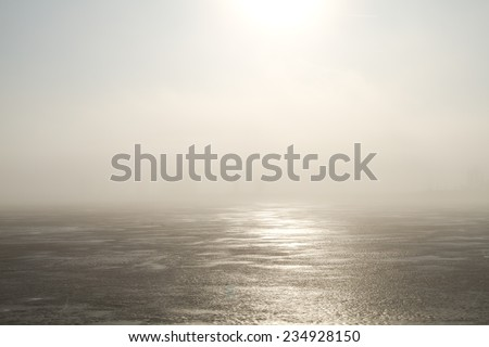 Frozen lake and sunlight in winter - stock photo