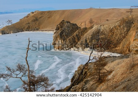 Frozen Lake Baikal. Frosty rocks of Olkhon Island in a sunny winter day - stock photo