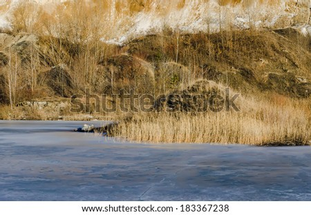 frozen lake in a mountains land - stock photo