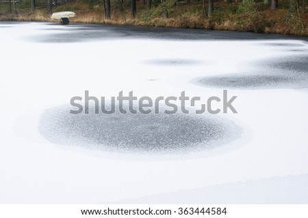 frozen lake in the woods, northern Germany - stock photo