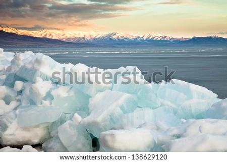 Frozen Lake with Chunks of Ice Piled in the Foreground - stock photo