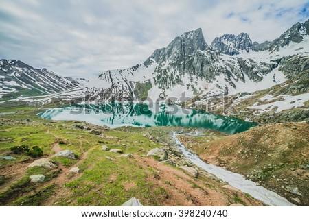 Frozen lake with mountain - stock photo