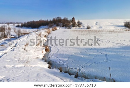 frozen lake with snow