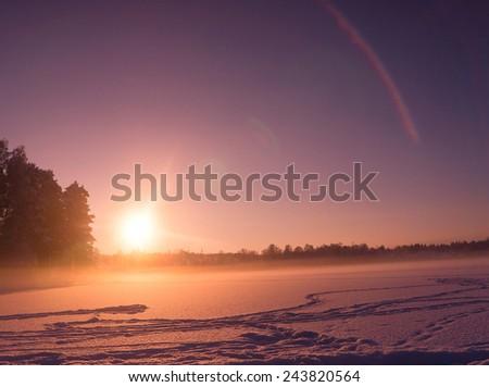 Frozen Landscape Setting Sun  - stock photo
