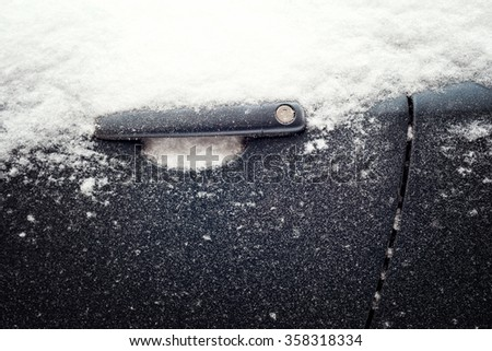 Frozen lock of a car. Shallow depth of field. - stock photo