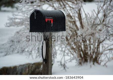 Frozen mailbox after ice storm - stock photo