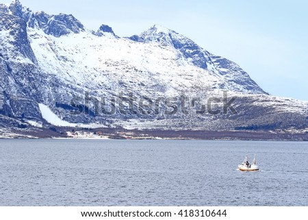 Frozen mountains near the Arctic Circle from a ship  Norway