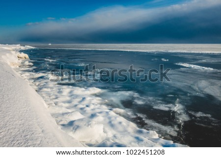 Frozen Ocean in the North of Canada during Sunny Day of Winter
