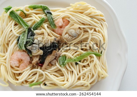 Frozen pasta, seafood and spinach spaghetti - stock photo