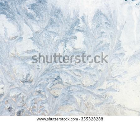 frozen pattern on the window surface - stock photo
