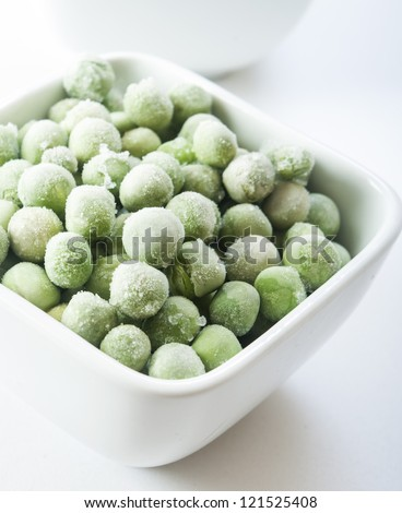 frozen peas close up in white background - stock photo