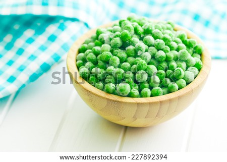 frozen peas in a wooden bowl - stock photo