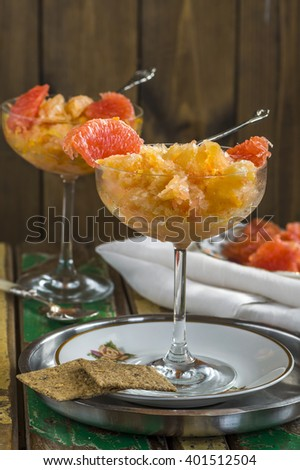 Frozen pink grapefruit granita slush drink - stock photo