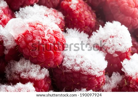 Frozen Raspberries. Red berries. Closeup. Macro. - stock photo