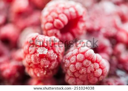 Frozen raspberry berries. Macro image with small depth of sharpness. Beautiful berries background - stock photo