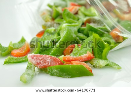 frozen red and green sweet peppers - stock photo