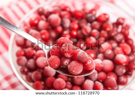 frozen red cranberry in bowl on napkin - stock photo