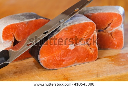 frozen red pieces of red fish. delicacy kosher food - stock photo