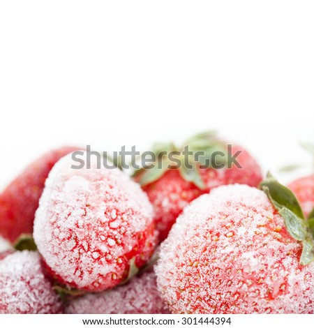 Frozen red strawberries. red fruit berries with a seed-studded surface, icy texture. Macro view, detailed ice crystal. copy space. white background. Shallow depth of field. - stock photo