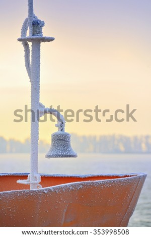 frozen ship bell in winter time - stock photo