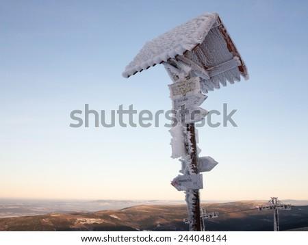 Frozen signpost - stock photo