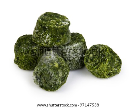 Frozen spinach isolated on white - stock photo
