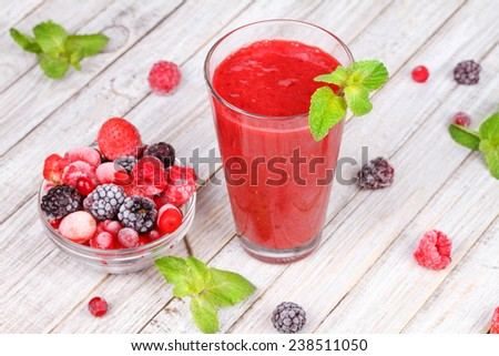 Frozen summer berries smoothie with mint - stock photo