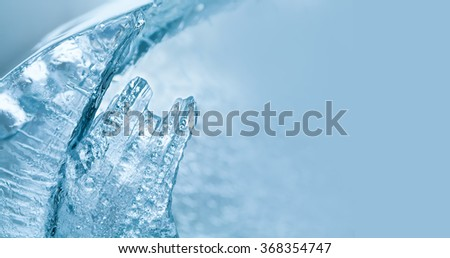 Frozen textured ice macro view. Winter time, cold weather postcard template. copy space, soft focus.