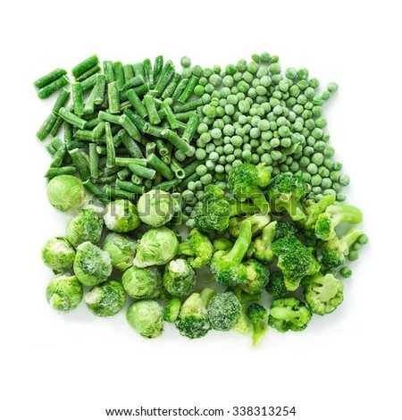 Frozen vegetables mix (green beans, peas, brussels sprout and broccoli) isolated over white, top view - stock photo
