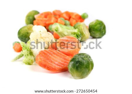 Frozen vegetables on white background - stock photo