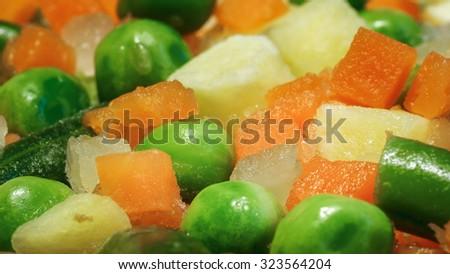 Frozen vegetables - peas, carrots, potatoes. Photographed close-up (macro). Useful vegetables. - stock photo