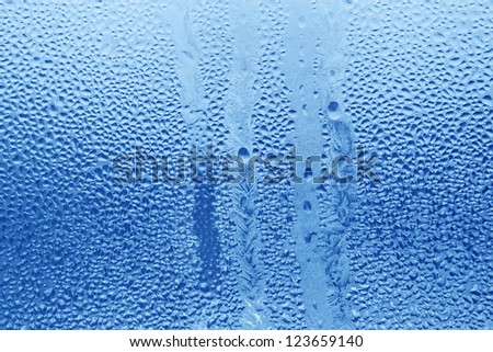 Frozen water drops on glass - stock photo