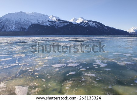 Frozen water of the Chilkat Inlet near Haines Alaska in winter on a sunny day. - stock photo