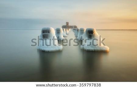 Frozen waterbreak in winter on the Baltic sea - stock photo
