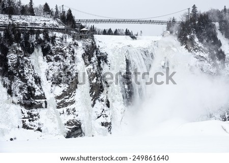 Frozen waterfall and extreme cold weather conditions make this area popular with climbers, hikers and extreme sport lovers in winter. The Montmorency Falls in winter, Quebec, Canada - stock photo