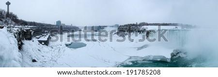 Frozen waterfall, Horseshoe Falls, Niagara River, Niagara Falls, Ontario, Canada - stock photo