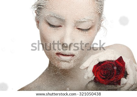 Frozen woman in snow and with rose in his hands Isolated on white - stock photo