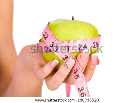 Fruit and measure tape as concepts of diet and healthy Life. - stock photo