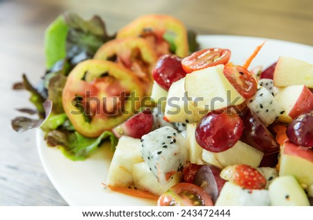 fruit and vegetable salad dish, spicy fruit salad - stock photo