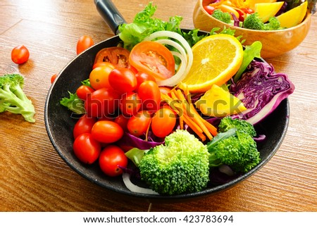 Fruit and vegetable salad on wood for clean green food concept - stock photo