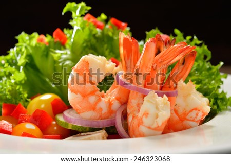 Fruit and vegetable salad with shrimps - stock photo