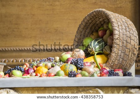 Fruit and vegetables fallen out of  wicker basket.