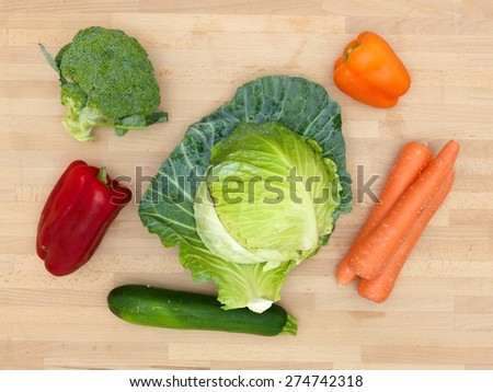 Fruit and vegetables on a wooden surface - stock photo