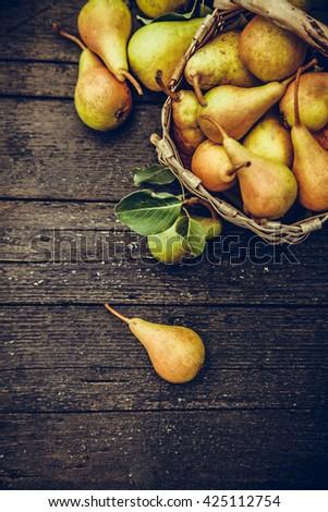 Fruit background. Fresh organic pears on old wood. Pear autumn harvest - stock photo